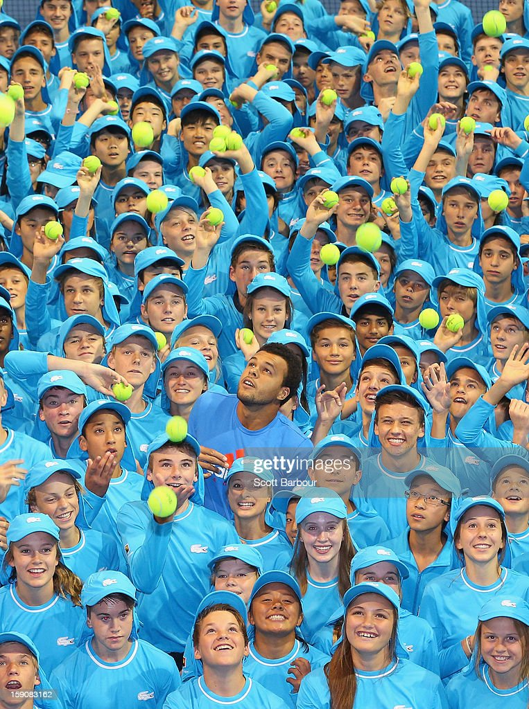 <a gi-track='captionPersonalityLinkClicked' href=/galleries/search?phrase=Jo-Wilfried+Tsonga&family=editorial&specificpeople=553803 ng-click='$event.stopPropagation()'>Jo-Wilfried Tsonga</a> (C) of France poses with the squad of 380 Australian Open 2013 ballkids at the National Tennis Centre ahead of the 2013 Australian Open at Melbourne Park on January 8, 2013 in Melbourne, Australia. The squad includes 20 ballkids from Korea, 6 from China and 23 from interstate.