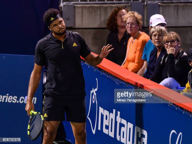 JoWilfried Tsonga of France reacts after losing a point against Sam Querrey of the United States during day six of the Rogers Cup presented by...