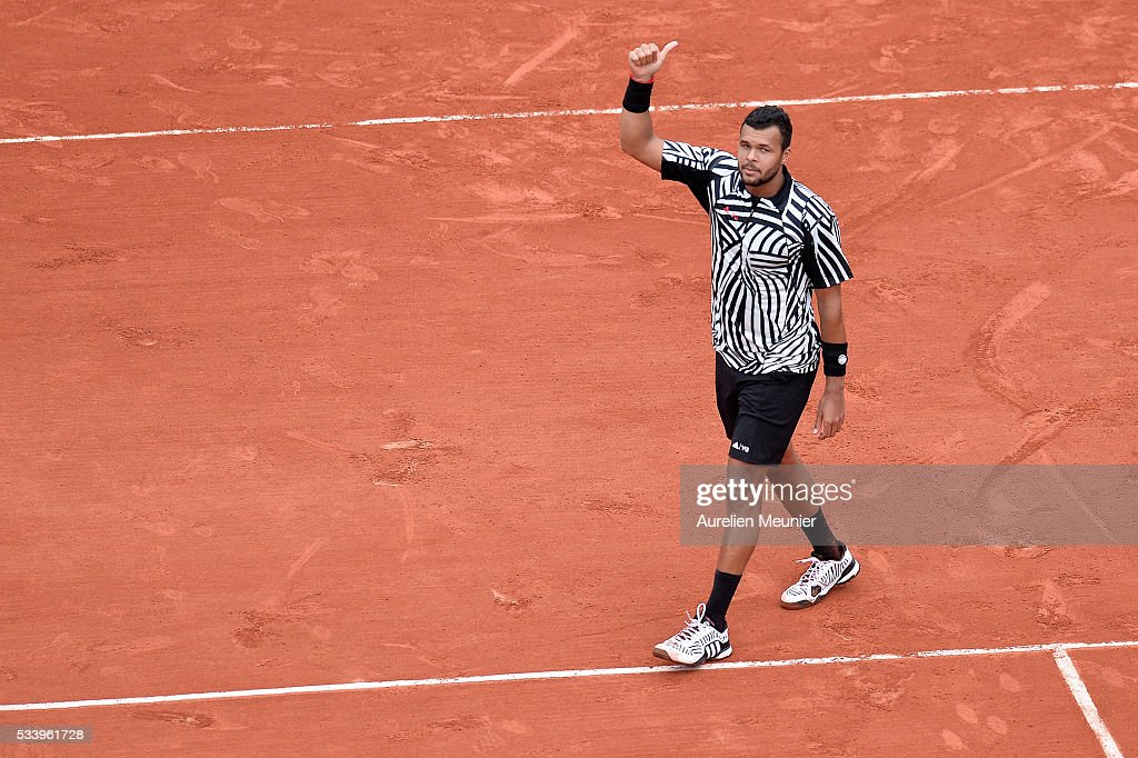 Jo-Wilfried Tsonga of France reacts after winning his men's single first round match against Jan-Lennard Struff of Germany at Roland Garros on May 24, 2016 in Paris, France.