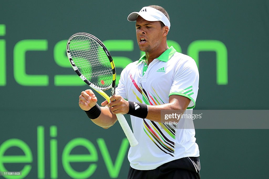 JoWilfried Tsonga of France reacts against Alexandr Dolgopolov of the Ukraine during the Sony Ericsson Open at Crandon Park Tennis Center on March 29...