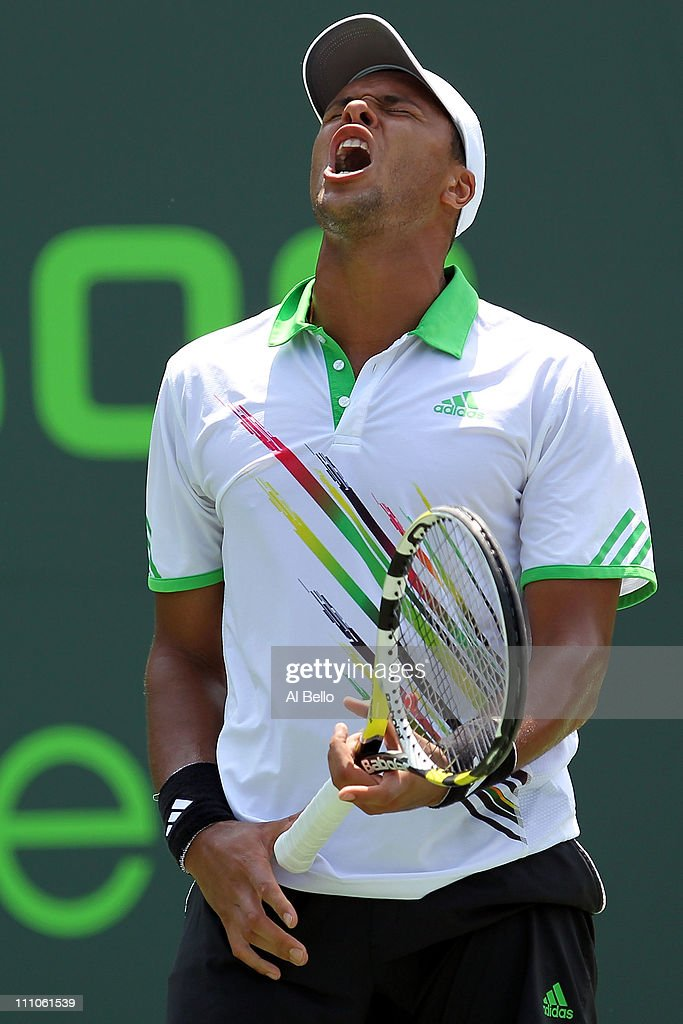 Jo-Wilfried Tsonga of France reacts against <a gi-track='captionPersonalityLinkClicked' href=/galleries/search?phrase=Alexandr+Dolgopolov&family=editorial&specificpeople=7025085 ng-click='$event.stopPropagation()'>Alexandr Dolgopolov</a> of the Ukraine during the Sony Ericsson Open at Crandon Park Tennis Center on March 29, 2011 in Key Biscayne, Florida.