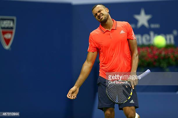 JoWilfried Tsonga of France reacts against Marin Cilic of Croatia during their Men's Singles Quarterfinals match on Day Nine of the 2015 US Open at...