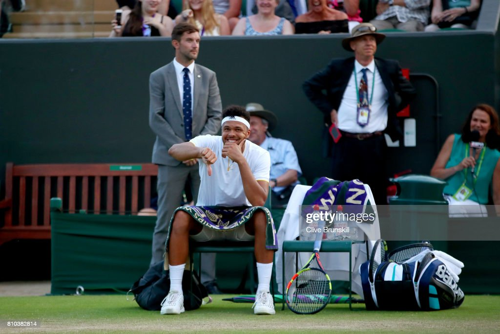 Jo-Wilfried Tsonga of France reacts as play is suspended during the Gentlemen's Singles third round match against Sam Querrey of The United States on day five of the Wimbledon Lawn Tennis Championships at the All England Lawn Tennis and Croquet Club on July 7, 2017 in London, England.