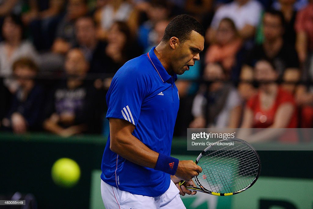 <a gi-track='captionPersonalityLinkClicked' href=/galleries/search?phrase=Jo-Wilfried+Tsonga&family=editorial&specificpeople=553803 ng-click='$event.stopPropagation()'>Jo-Wilfried Tsonga</a> of France reacts during his match against Tobias Kamke of Germany during day 3 of the Davis Cup Quarter Final match between France and Germany on April 6, 2014 in Nancy, France.