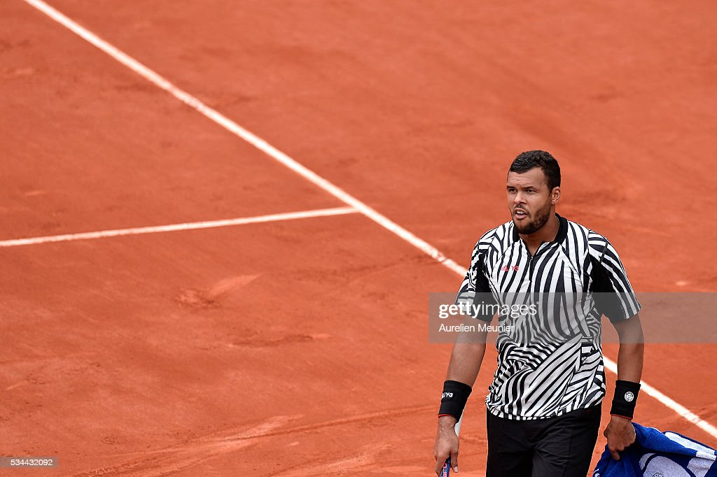 Jo-Wilfried Tsonga of France reacts during his men's single second round match against Marcos Baghaditis of Cyprus on day five of the 2016 French Open at Roland Garros on May 26, 2016 in Paris, France.