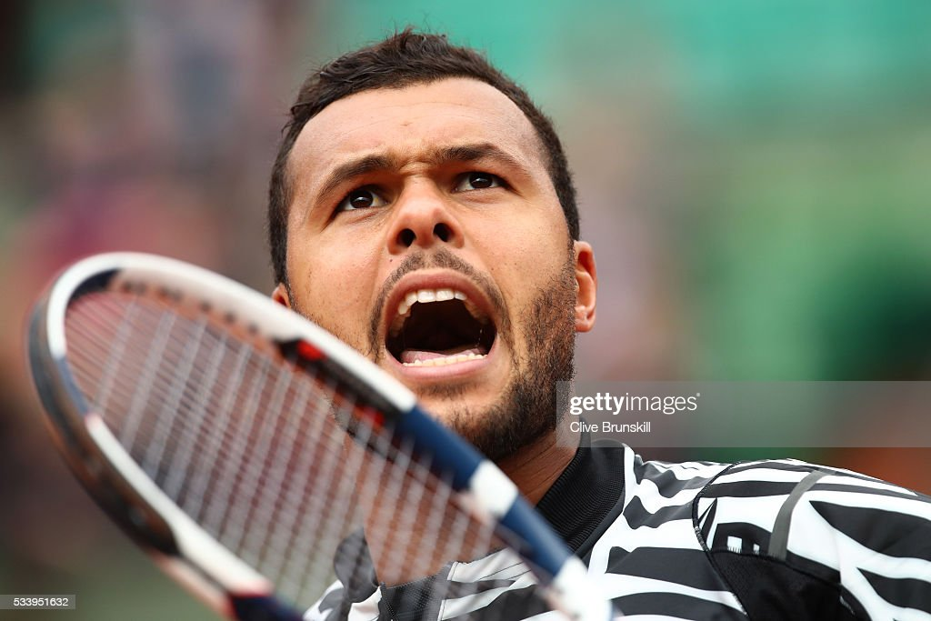 Jo-Wilfried Tsonga of France reacts during the Men's Singles first round match against Jan-Lennard Struff of Germany on day three of the 2016 French Open at Roland Garros on May 24, 2016 in Paris, France.