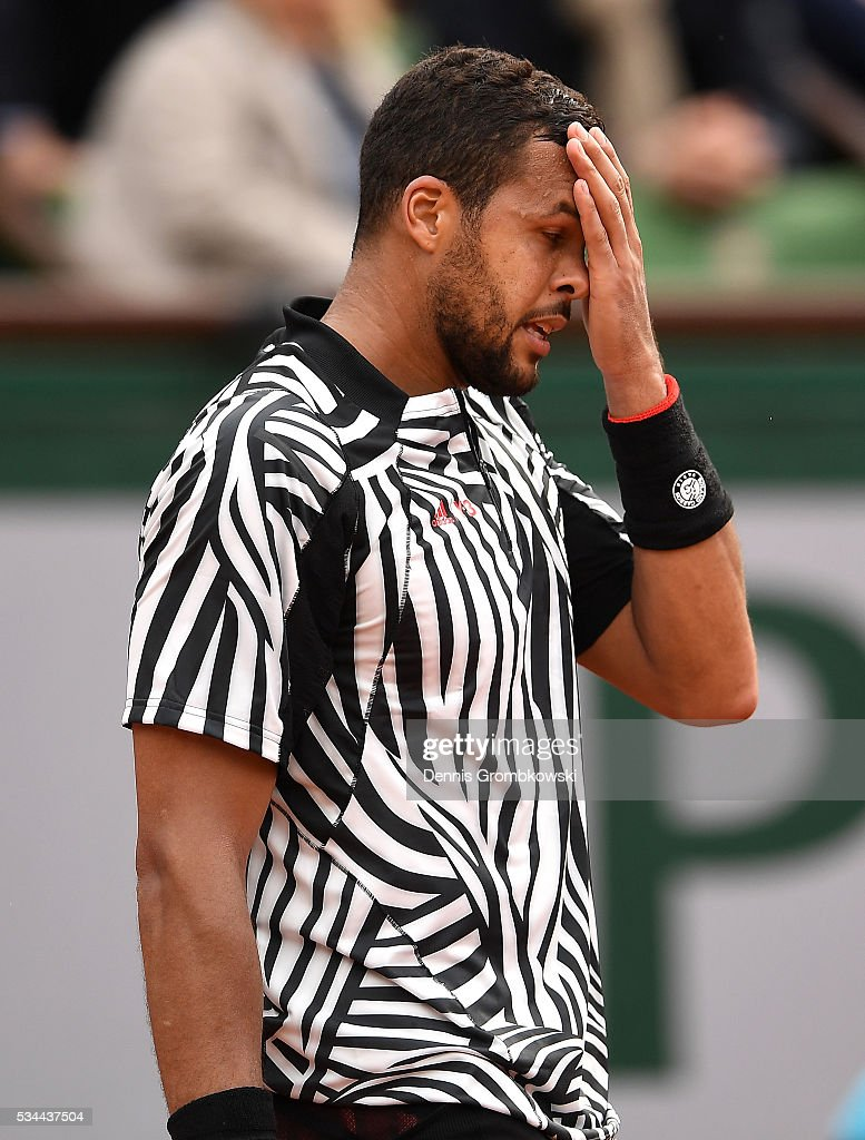 <a gi-track='captionPersonalityLinkClicked' href=/galleries/search?phrase=Jo-Wilfried+Tsonga&family=editorial&specificpeople=553803 ng-click='$event.stopPropagation()'>Jo-Wilfried Tsonga</a> of France reacts during the Men's Singles second round match against Marcos Baghdatis of Cyprus on day five of the 2016 French Open at Roland Garros on May 26, 2016 in Paris, France.