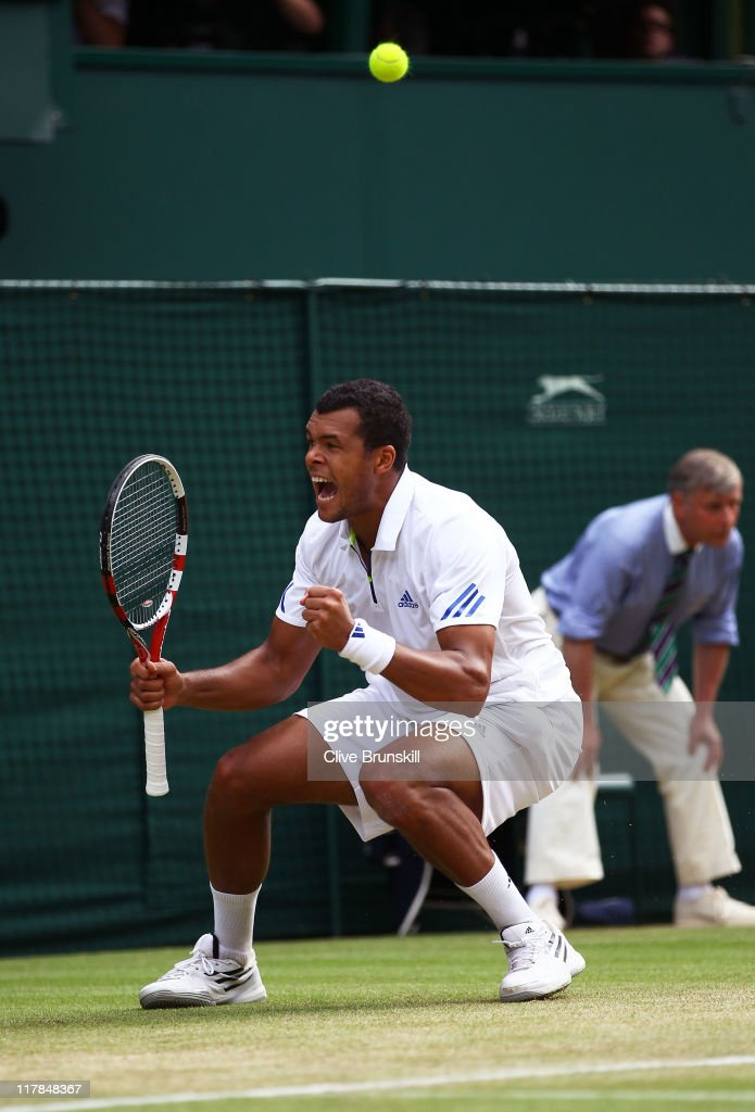 Jo-Wilfried Tsonga of France reacts to a play during his semifinal round match against Novak Djokovic of Serbia on Day Eleven of the Wimbledon Lawn Tennis Championships at the All England Lawn Tennis and Croquet Club on July 1, 2011 in London, England.