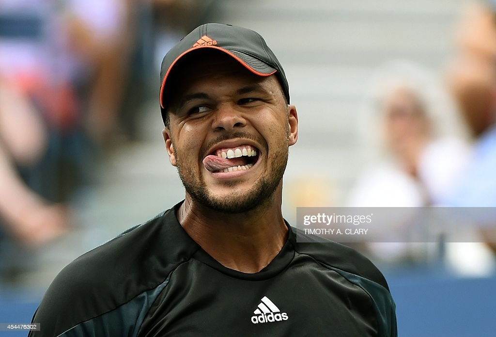 Jo-Wilfried Tsonga of France reacts while playing Andy Murray of Great Britian during their 2014 US Open men's singles match at the USTA Billie Jean King National Tennis Center September 1, 2014 in New York.