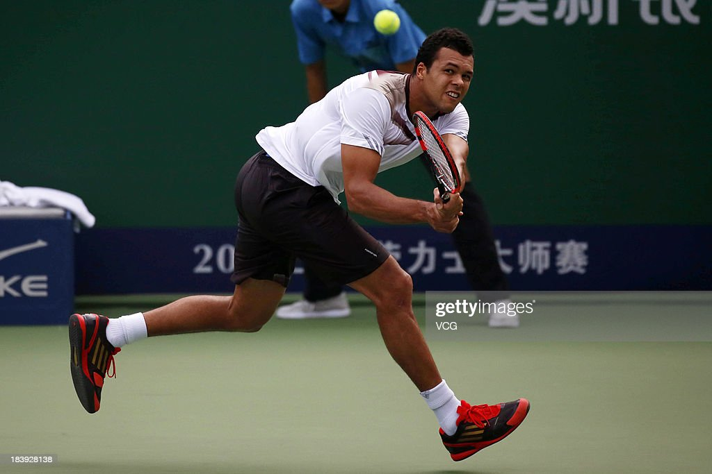<a gi-track='captionPersonalityLinkClicked' href=/galleries/search?phrase=Jo-Wilfried+Tsonga&family=editorial&specificpeople=553803 ng-click='$event.stopPropagation()'>Jo-Wilfried Tsonga</a> of France returns a ball to Pablo Andujar of Spain on day three of the Shanghai Rolex Masters at the Qi Zhong Tennis Center on October 9, 2013 in Shanghai, China.