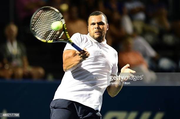 JoWilfried Tsonga of France returns a shot from Denis Istomin of Uzbekistan during the second day of the WinstonSalem Open at Wake Forest University...