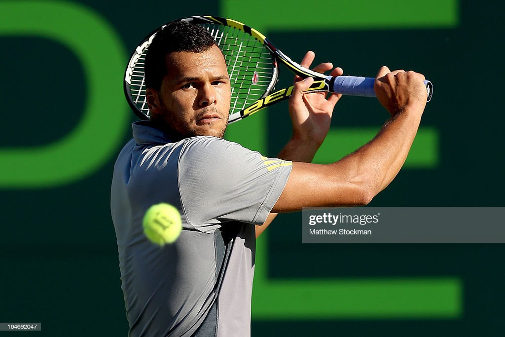 Jo-Wilfried Tsonga of France returns a shot to Marin Cilic of Croatia during the Sony Open at Crandon Park Tennis Center on March 26, 2013 in Key Biscayne, Florida.