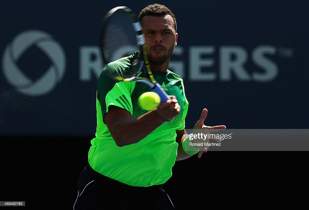 <a gi-track='captionPersonalityLinkClicked' href=/galleries/search?phrase=Jo-Wilfried+Tsonga&family=editorial&specificpeople=553803 ng-click='$event.stopPropagation()'>Jo-Wilfried Tsonga</a> of France returns a shot to Roger Federer of Switzerland in their finals match during Rogers Cup at Rexall Centre at York University on August 10, 2014 in Toronto, Canada.