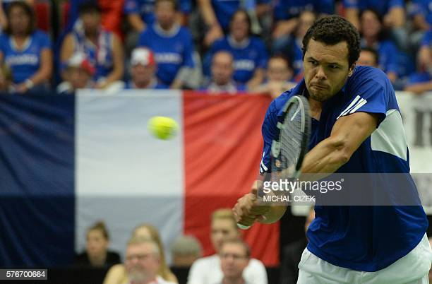 JoWilfried Tsonga of France returns the ball to Jiri Vesely of Czech Republic during their tennis match at the International Tennis Federation Davis...