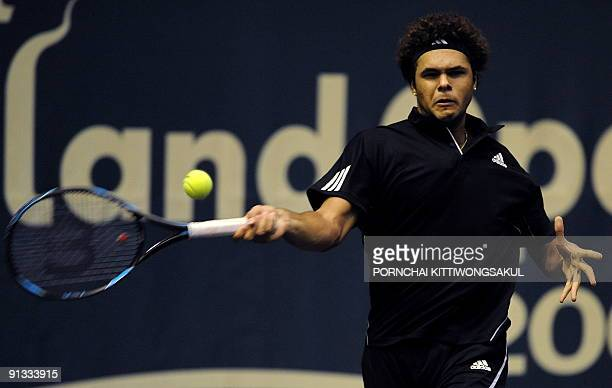 JoWilfried Tsonga of France returns to Macro Chiudinelli of Switzerland during their quarterfinal round of ATP Thailand Open tennis tournament match...