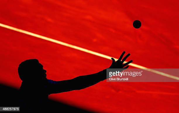 JoWilfried Tsonga of France serves against Edouard RogerVasselin of France in their first round match during day three of the Mutua Madrid Open...