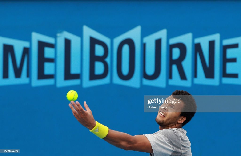Jo-Wilfried Tsonga of France serves ahead of the 2013 Australian Open at Melbourne Park on January 12, 2013 in Melbourne, Australia.