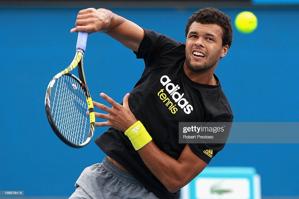 Jo-Wilfried Tsonga of France serves ahead of the 2013 Australian Open at Melbourne Park on January 13, 2013 in Melbourne, Australia.