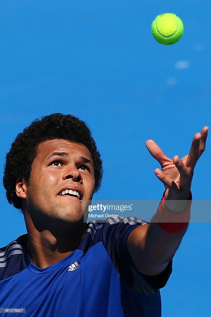<a gi-track='captionPersonalityLinkClicked' href=/galleries/search?phrase=Jo-Wilfried+Tsonga&family=editorial&specificpeople=553803 ng-click='$event.stopPropagation()'>Jo-Wilfried Tsonga</a> of France serves during a practice session ahead of the 2014 Australian Open at Melbourne Park on January 8, 2014 in Melbourne, Australia.