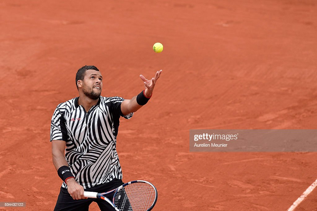 Jo-Wilfried Tsonga of France serves during his men's single second round match against Marcos Baghaditis of Cyprus on day five of the 2016 French Open at Roland Garros on May 26, 2016 in Paris, France.