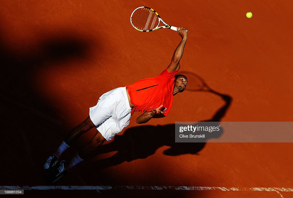 Jo-Wilfried Tsonga of France serves during the men's singles first round match between Jo-Wilfried Tsonga of France and Daniel Brands of Germany at the French Open on day one of the French Open at Roland Garros on May 23, 2010 in Paris, France.