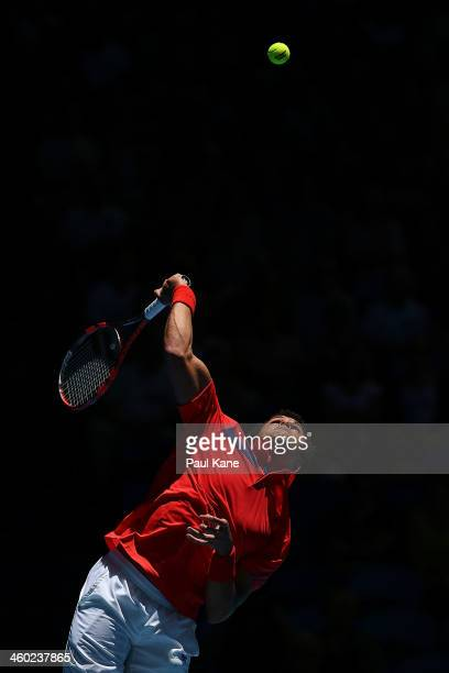 JoWilfried Tsonga of France serves to Daniel MunozDe La Nava of Spain in the men's singles match during day seven of the Hopman Cup at Perth Arena on...
