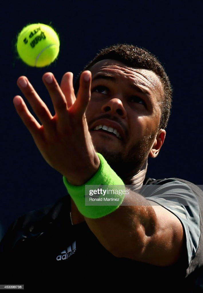 <a gi-track='captionPersonalityLinkClicked' href=/galleries/search?phrase=Jo-Wilfried+Tsonga&family=editorial&specificpeople=553803 ng-click='$event.stopPropagation()'>Jo-Wilfried Tsonga</a> of France serves to Grigor Dimitrov of Bulgaria during Rogers Cup at Rexall Centre at York University on August 9, 2014 in Toronto, Canada.
