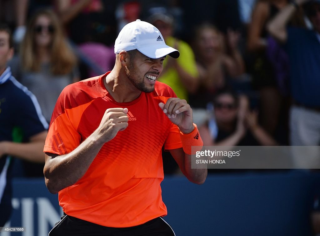 Jo-Wilfried Tsonga of France shadow boxes on the court after he defeated Aleksandr Nedovyesov of Kazakhstan during their 2014 US Open men's singles match at the USTA Billie Jean King National Tennis Center August 28, 2014 in New York. Tsonga won 6-3, 6-4, 6-4. AFP PHOTO/Stan HONDA