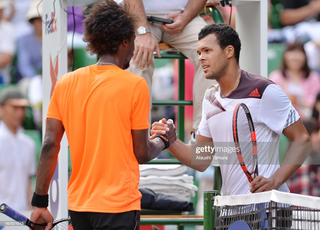 Jo-Wilfried Tsonga of France (R) shakes hands with Gael Monfils of France after the men's first round match between Jo-Wilfried Tsonga of France and Gael Monfils of France during day one of the Rakuten Open at Ariake Colosseum on September 30, 2013 in Tokyo, Japan.