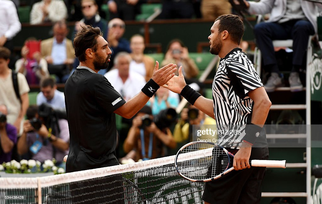 <a gi-track='captionPersonalityLinkClicked' href=/galleries/search?phrase=Jo-Wilfried+Tsonga&family=editorial&specificpeople=553803 ng-click='$event.stopPropagation()'>Jo-Wilfried Tsonga</a> of France shakes hands with <a gi-track='captionPersonalityLinkClicked' href=/galleries/search?phrase=Marcos+Baghdatis&family=editorial&specificpeople=226943 ng-click='$event.stopPropagation()'>Marcos Baghdatis</a> of Cyprus following his victory during the Men's Singles second round match on day five of the 2016 French Open at Roland Garros on May 26, 2016 in Paris, France.