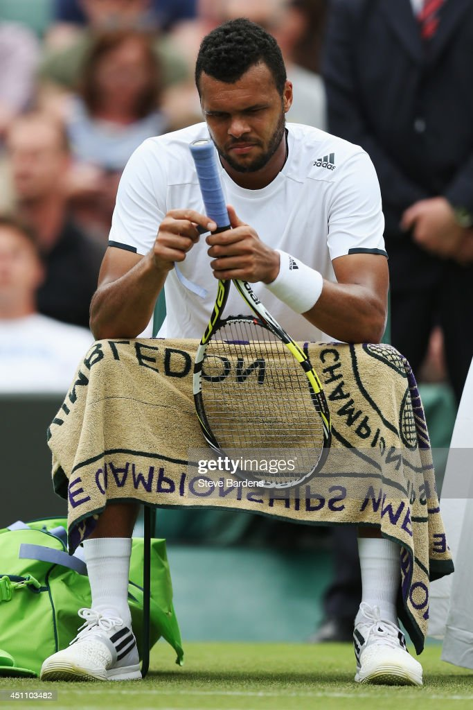 Jo-Wilfried Tsonga of France sits dejected during his Gentlemen's Singles first round match against Jurgen Melzer of Austria on day one of the Wimbledon Lawn Tennis Championships at the All England Lawn Tennis and Croquet Club at Wimbledon on June 23, 2014 in London, England.