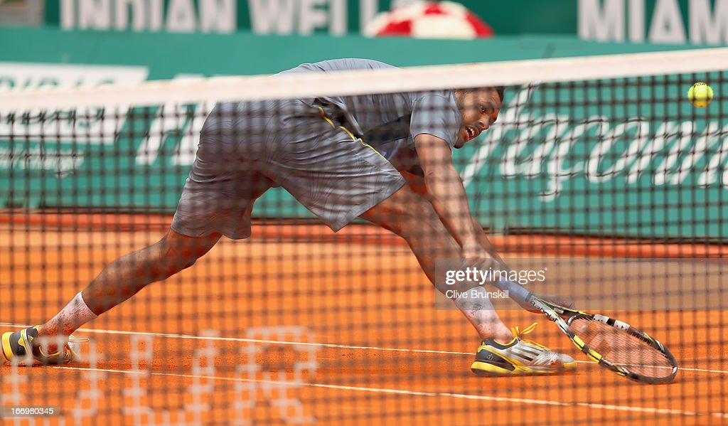 Jo-Wilfried Tsonga of France stretches for a backhand volley against Stanislas Wawrinka of Switzerland in their quarter final match during day six of the ATP Monte Carlo Masters,at Monte-Carlo Sporting Club on April 19, 2013 in Monte-Carlo, Monaco.