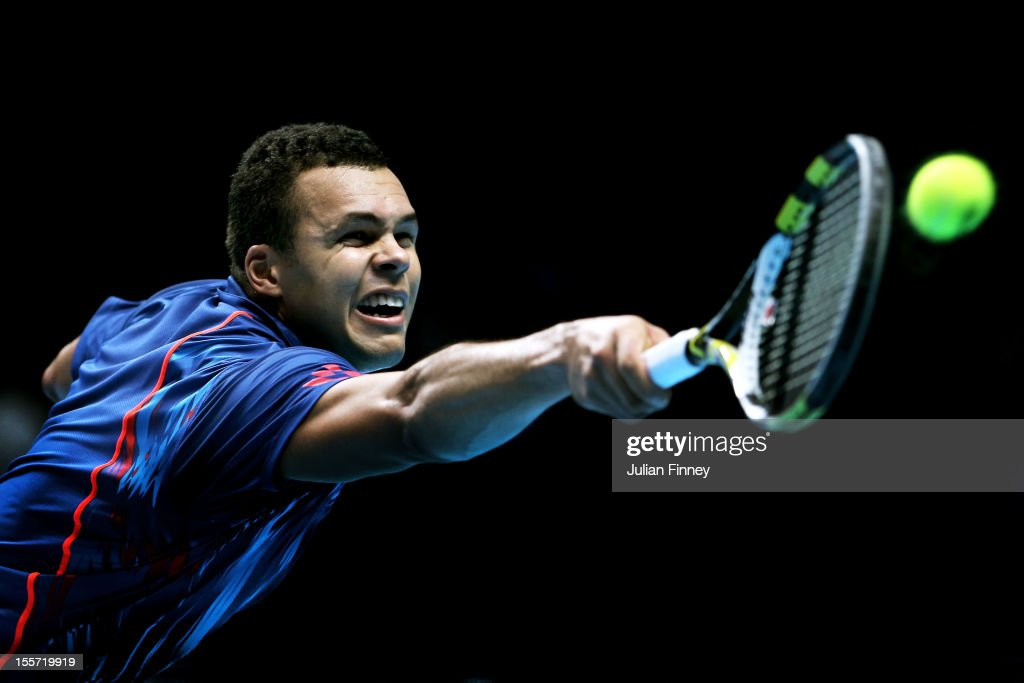 <a gi-track='captionPersonalityLinkClicked' href=/galleries/search?phrase=Jo-Wilfried+Tsonga&family=editorial&specificpeople=553803 ng-click='$event.stopPropagation()'>Jo-Wilfried Tsonga</a> of France stretches in vain to hit a forehand during the men's singles match against Tomas Berdych of Czech Republic on day three of the ATP World Tour Finals at the at O2 Arena on November 7, 2012 in London, England.