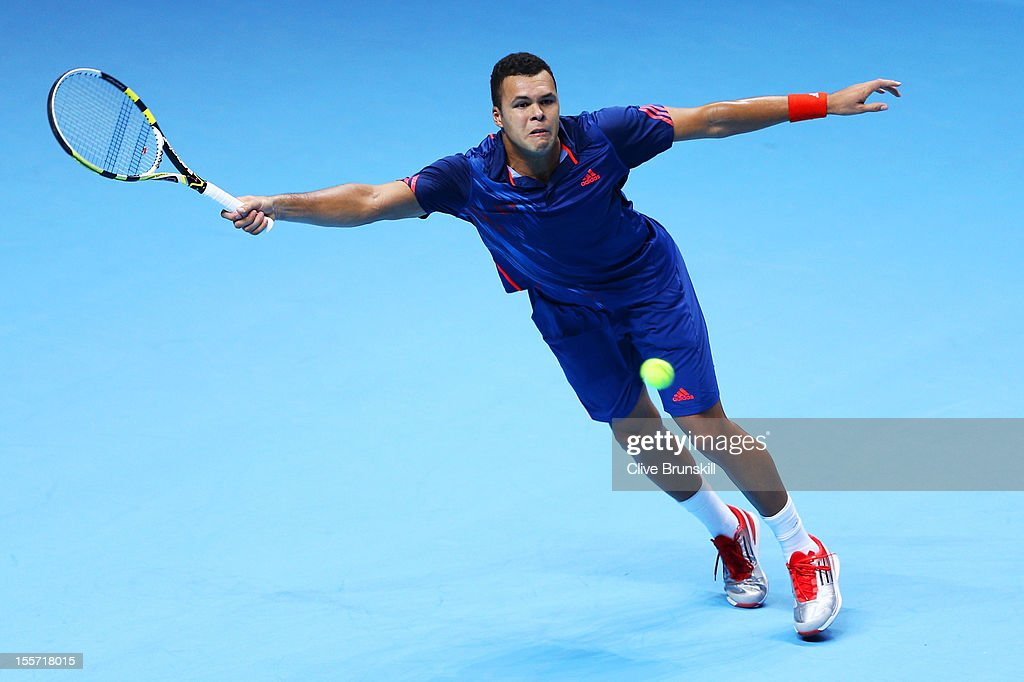 <a gi-track='captionPersonalityLinkClicked' href=/galleries/search?phrase=Jo-Wilfried+Tsonga&family=editorial&specificpeople=553803 ng-click='$event.stopPropagation()'>Jo-Wilfried Tsonga</a> of France stretches to hit a forehand during the men's singles match against Tomas Berdych of Czech Republic on day three of the ATP World Tour Finals at the at O2 Arena on November 7, 2012 in London, England.