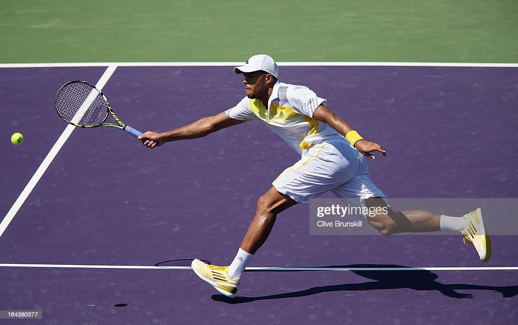 <a gi-track='captionPersonalityLinkClicked' href=/galleries/search?phrase=Jo-Wilfried+Tsonga&family=editorial&specificpeople=553803 ng-click='$event.stopPropagation()'>Jo-Wilfried Tsonga</a> of France stretches to play a volley against ViktorTroicki of Serbia during their second round match at the Sony Open at Crandon Park Tennis Center on March 23, 2013 in Key Biscayne, Florida.