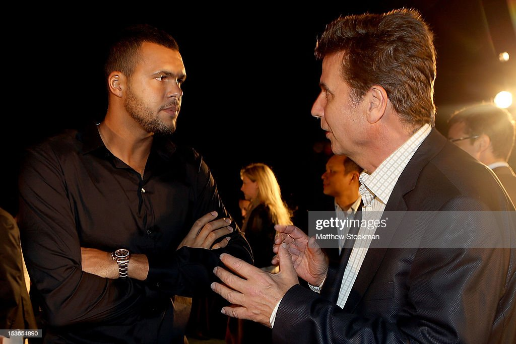 JoWilfried Tsonga of France talks to ATP Executive Chairman President Brad Drewett during a reception for the Shanghai Rolex Masters at the Hilton...