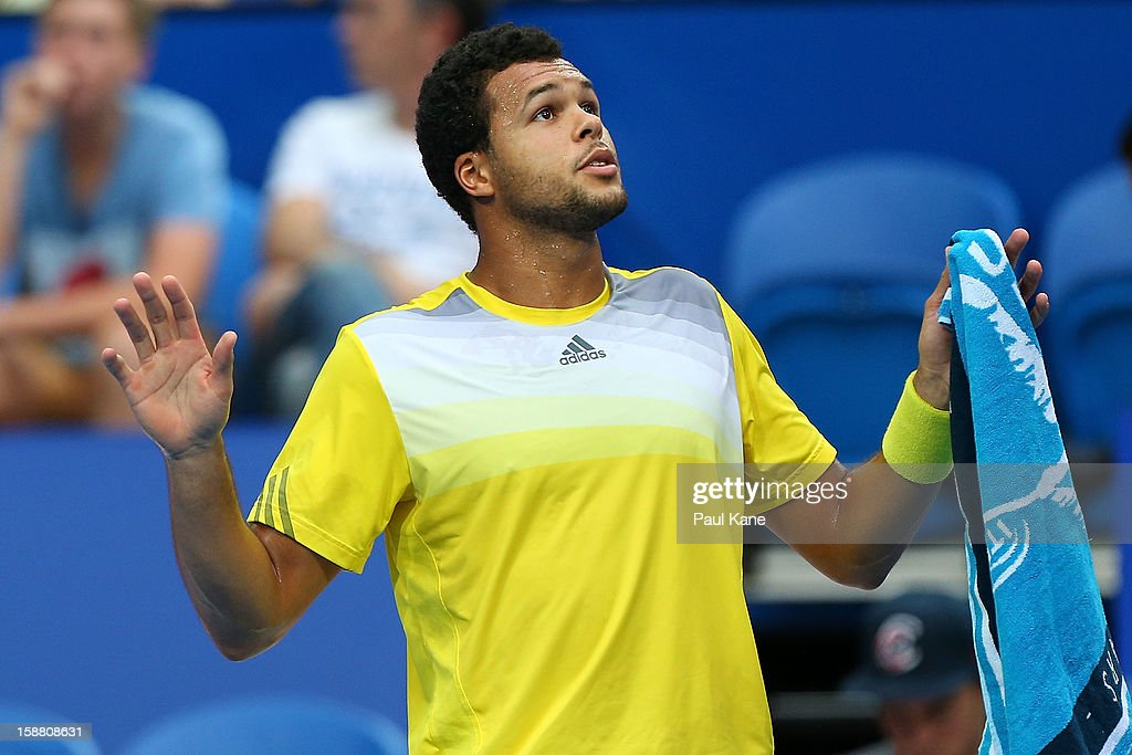 Jo-Wilfried Tsonga of France talks with the chair umpire in his singles match against Fernando Verdasco of Spain during day two of the Hopman Cup at Perth Arena on December 30, 2012 in Perth, Australia.