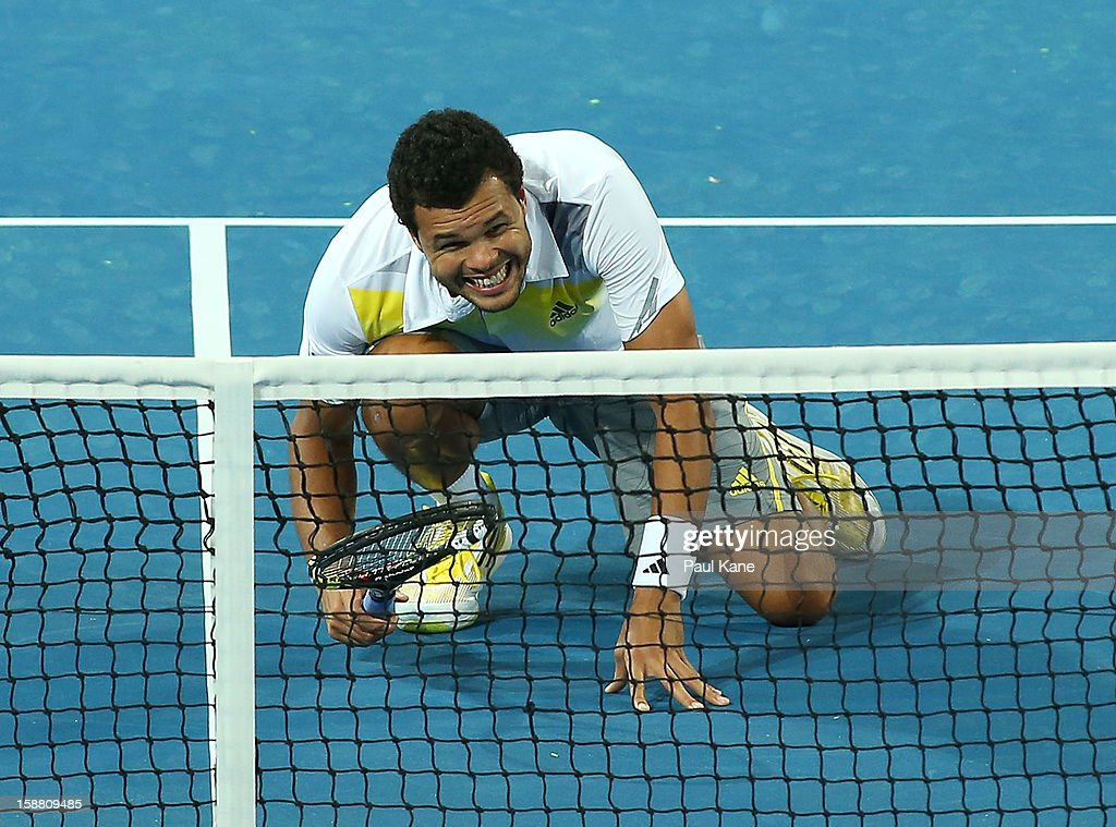 <a gi-track='captionPersonalityLinkClicked' href=/galleries/search?phrase=Jo-Wilfried+Tsonga&family=editorial&specificpeople=553803 ng-click='$event.stopPropagation()'>Jo-Wilfried Tsonga</a> of France waits for Mathilde Johansson to serve in their mixed doubles match against Fernando Verdasco and Anabel Medina Garrigues of Spain during day two of the Hopman Cup at Perth Arena on December 30, 2012 in Perth, Australia.