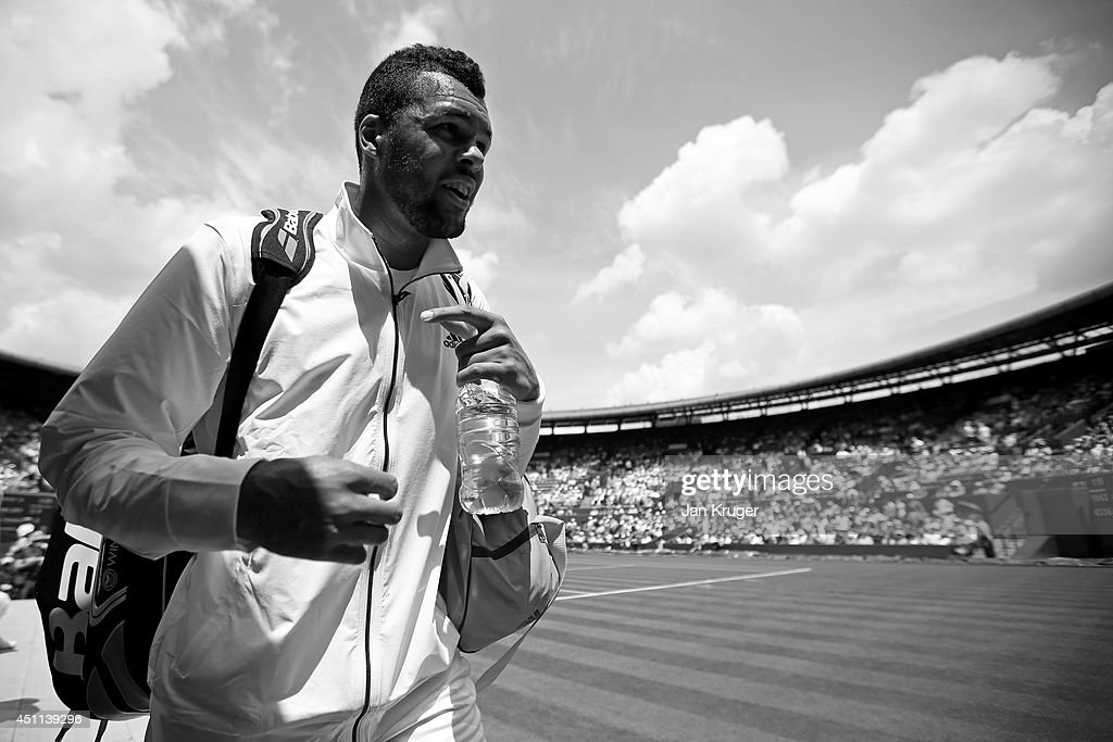 Jo-Wilfried Tsonga of France walks off court after winning his Gentlemen's Singles first round match against Jurgen Melzer of Austria on day two of the Wimbledon Lawn Tennis Championships at the All England Lawn Tennis and Croquet Club at Wimbledon on June 24, 2014 in London, England.