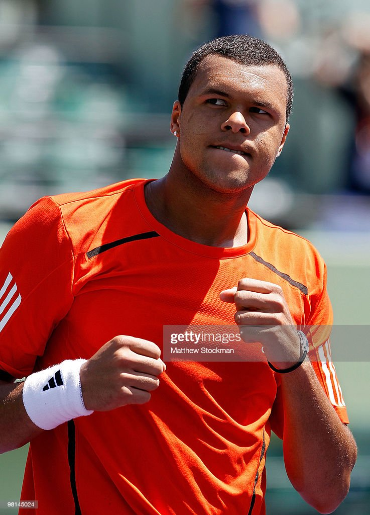 <a gi-track='captionPersonalityLinkClicked' href=/galleries/search?phrase=Jo-Wilfried+Tsonga&family=editorial&specificpeople=553803 ng-click='$event.stopPropagation()'>Jo-Wilfried Tsonga</a> reacts after defeating Juan Carlos Ferrero of Spain during day eight of the 2010 Sony Ericsson Open at Crandon Park Tennis Center on March 30, 2010 in Key Biscayne, Florida.