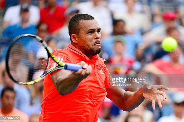 JoWilfried Tsonga returns a shot to Marin Cilic of Croatia during their Men's Singles Quarterfinals match on Day Nine of the 2015 US Open at the USTA...