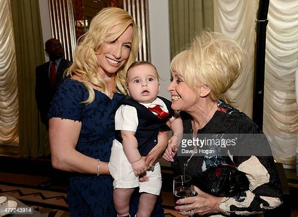 Joy Desmond with baby Valentine and Barbara Windsor attend the book launch of Richard Desmond's 'The Real Deal' at Claridge's on June 15 2015 in...