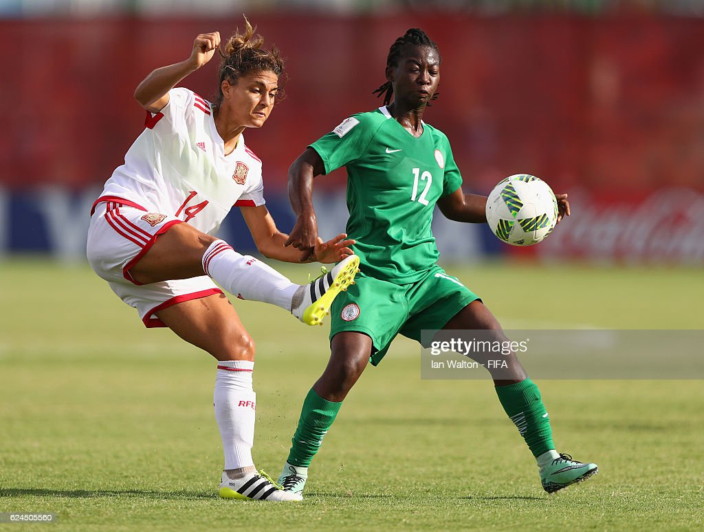 Joy Ebinemiere Bokiri of Nigeria tries to tackle Sandra Hernandez Rodriguez of Spain during the FIFA U-20 Women's World Cup, Group B match between Nigeria and Spain at PNG Football Stadium on November 20, 2016 in Port Moresby, Papua New Guinea.
