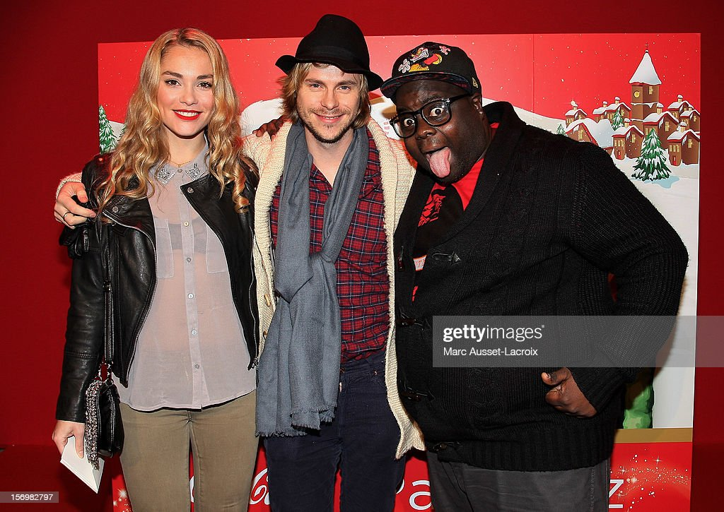 Joy Esther and Jean-Baptiste Shelmerdine and Issa Doumbia poses at the Coca Cola Christmas windows inauguration at Le Showcase on November 26, 2012 in Paris, France.
