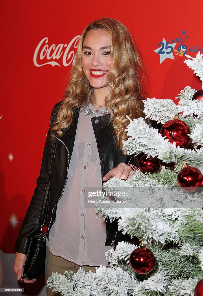 Joy Esther poses at the Coca Cola Christmas windows inauguration at Le Showcase on November 26, 2012 in Paris, France.