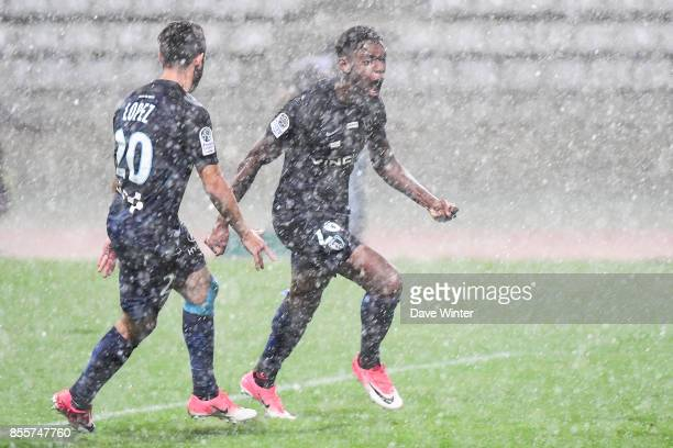 Joy for Dylan Saint Louis of Paris FC as he puts his side 2 ahead in the pouring rain during the Ligue 2 match between Paris FC and Nimes on...