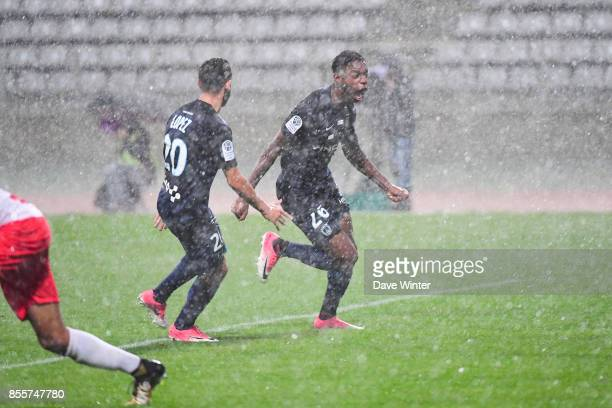 Joy for Dylan Saint Louis of Paris FC as he puts his side 21 ahead as the heavy rain comes down during the Ligue 2 match between Paris FC and Nimes...