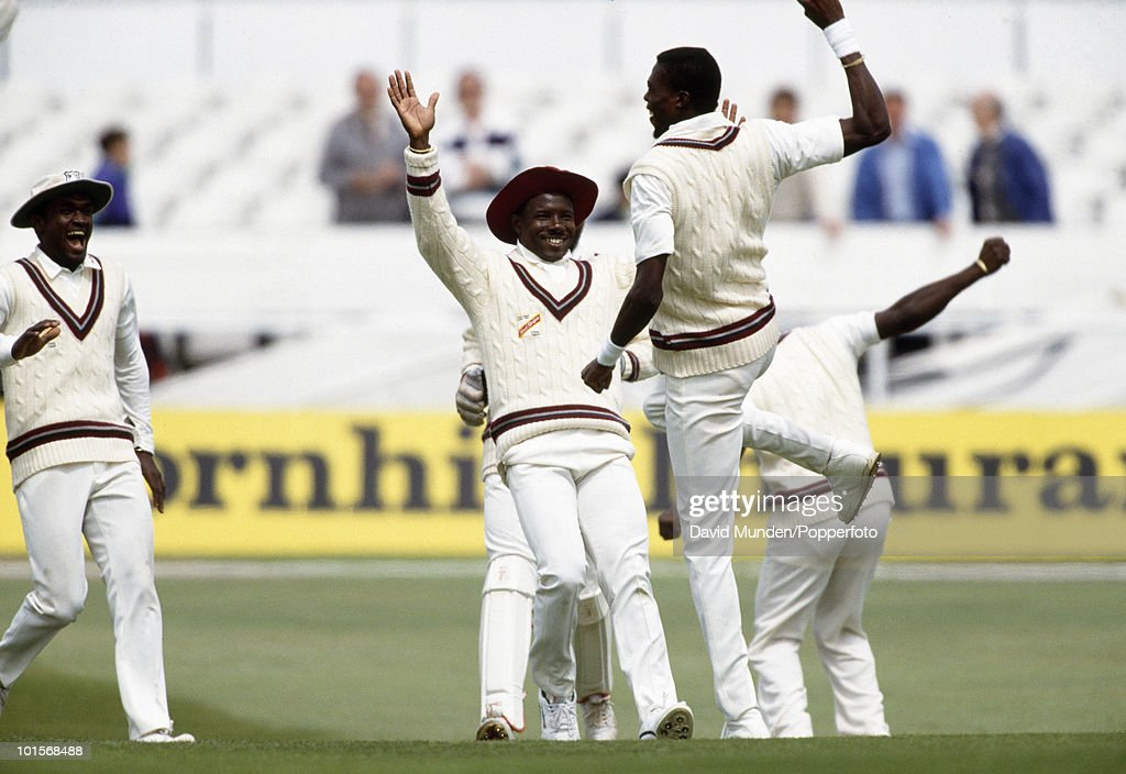 Joy for the West Indies as Richie Richardson runs to congratulate Curtly Ambrose who has bowled England batsman Graeme Hick (not in picture) for 6 on the third day of the 1st Test Match between England and the West Indies at Headingley in Leeds, 8th June 1991. England won by 115 runs.