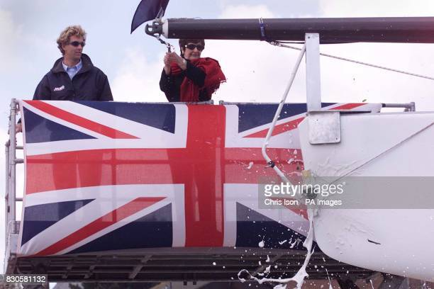 Joy Harrison wife of entrepreneur Peter Harrison smashes a bottle of champagne on the bow of 'Asura' at a blessing ceremony in Cowes on the Isle of...