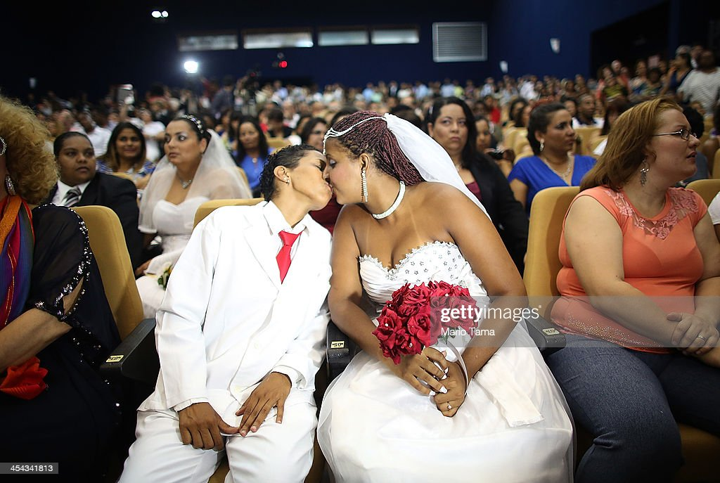 Joyce and Gabrieli (R) kiss before marrying at what was billed as the world's largest communal gay wedding on December 8, 2013 in Rio de Janeiro, Brazil. 130 couples were married at the event which was held at the Court of Justice in downtown Rio. In May, Brazil became the third country in Latin America to effectively approve same-sex marriage via a court ruling, but a final law has yet to be passed.